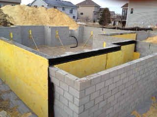 New Home Construction foundation ready for backfill 2