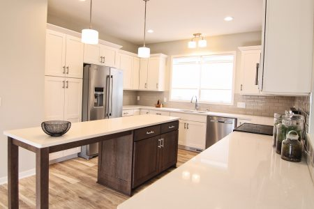 Wellborn Cabinet Inc cabinetry, Quartz countertops, white painted millwork